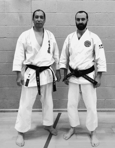 Shinji Tanaka and Alberto Scarpellini standing side by side